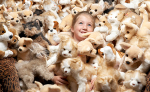83987139-close-up-of-a-girl-surrounded-by-stuffed-toys-gettyimages